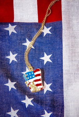 Necklace with statue of liberty on the american flag