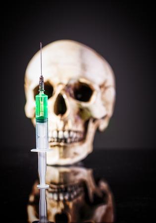 Syringe over human skull