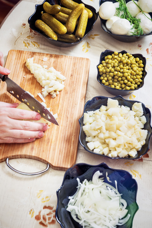 preparing russian salad Olivier