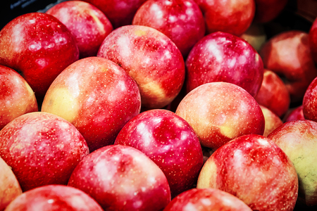 many fresh raw red apples as background