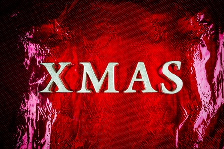 Word Xmas made from wooden letters on the red background