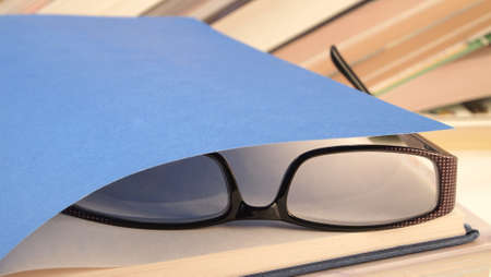 Glasses lying on the open book Stock Photo - 17596766