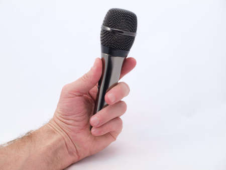 Black brilliant microphone in a man's hand Stock Photo - 18239775