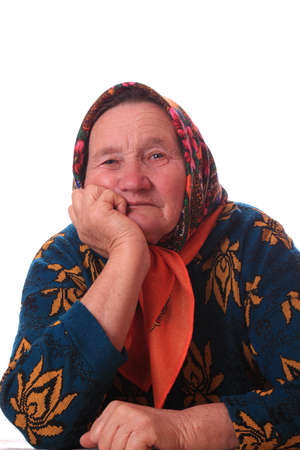 Portrait of the elderly good-natured woman on white