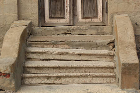 scabrous: Old damaged steps before the input in the house