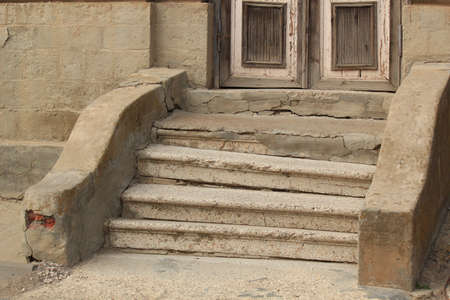 corroding: Old damaged steps before the input in the house