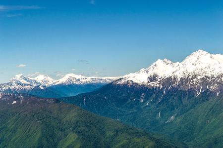 Mountain valley with snow-capped mountain peaks. height 2320 above sea level Esto-Sadok Russia Sochi Фото со стока