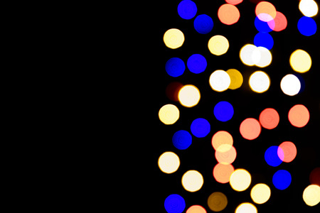 Abstract festive background with photo realistic bokeh defocused lights. Christmas atmosphere shining into the space.