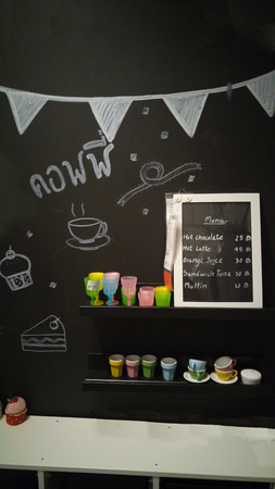 simulate: Coffee menu on chalkboard with colorful coffee cup and white coffee table on chalkboard backgroundFake coffee house Stock Photo