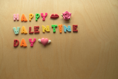 romantic heart: Colorful valentine text with pink heart pink flower red lips on wooden backgroundHappy valentine day