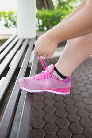 woman tie: Woman tie pink sneaker get ready to run and exercise for healthy Tie your sneaker and run