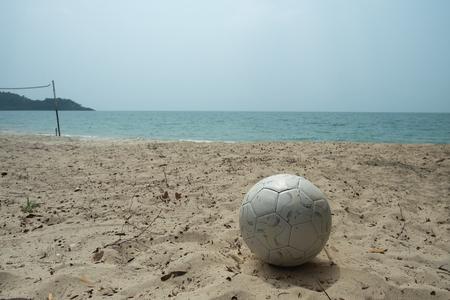 kick off: Kick off football on beach, sea, sand, mountain and netFootball on beach, sea, sand and mountain