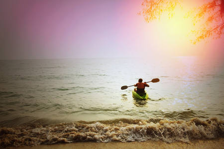 skinhead: Skinhead Caucasian man on kayak on ocean near beach start new adventure in summer Skinhead Caucasian man on kayak on beach in summer