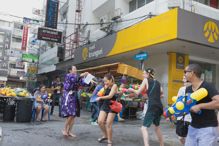 silom: Songkran day in songkran festival in April which is thai new year when tourist come to Bangkok and play water fighting on streetSongkran day Thai new year