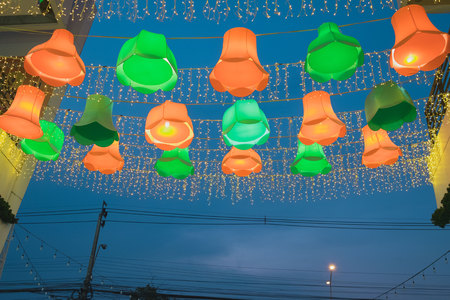 outdoor electricity: Orange and green beautiful lamp outdoor outside shopping mall night bazaar with electricity post and cableBeautiful lamp outside shopping mall night bazaar