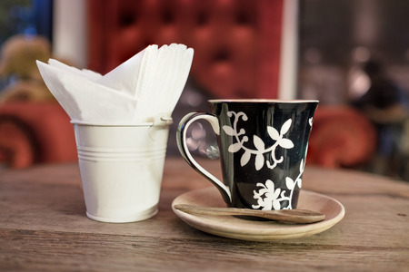 glass paper: hot coffee with tissue paper coffee on wooden table coffee coffee near red sofa