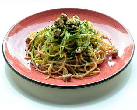 Spaghetti (from the Italian, spaghetti [spaɡetti]; singular, spaghetto) is a type of Italian pasta made with hard grain flour and water.