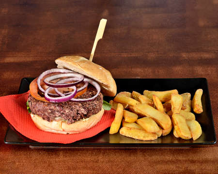 Hamburger with purple onion chip potatoes and sauce