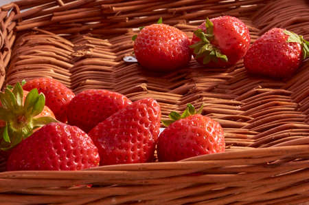 Strawberries in a cane basket, long exposure with natural light