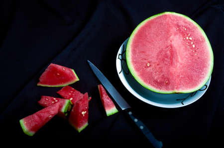 Watermelon chopped black background