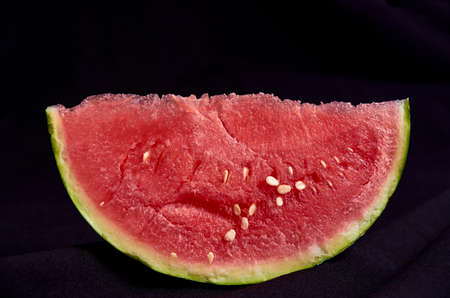 Image slice of watermelon black background Banque d'images