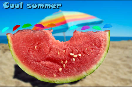 slice of watermelon with bite beach background and umbrellas on top