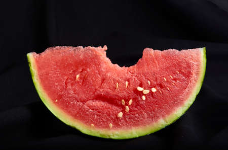 Image slice of watermelon with bite black