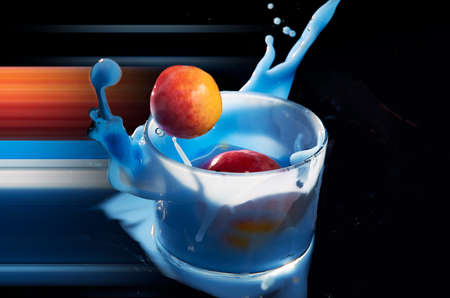 Apricot falling into a glass of blue smoothie