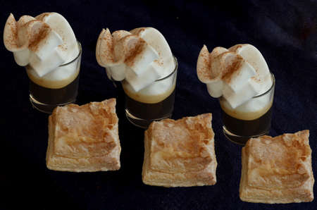 Three cups of coffee with cream and pastries typical of Castilla La Mancha