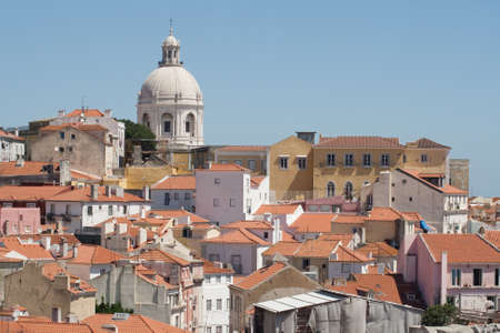 Lisbon roofs and church in Alfama