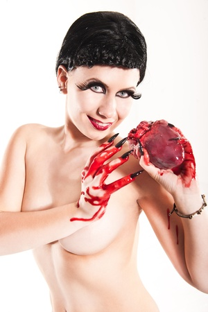young girl with bloody heart