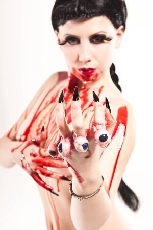young girl with bloody eyes Stock Photo
