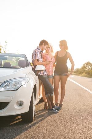 friends beside a car