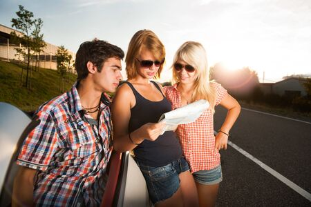 fiends beside a car studying a roadmap Stock Photo - 17718293