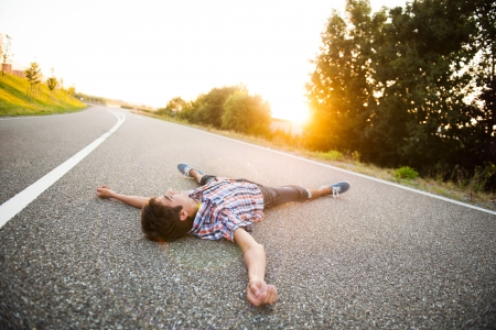 young man dead on the street Stock Photo