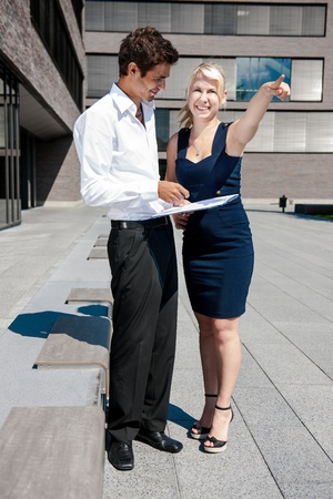 Businesswoman with board explaining a female colleague a project Stock Photo - 17718304
