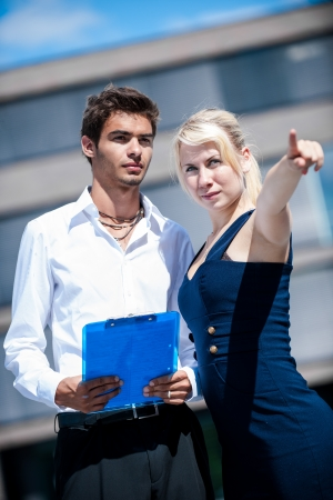 Businesswoman with board explaining a female colleague a project Stock Photo