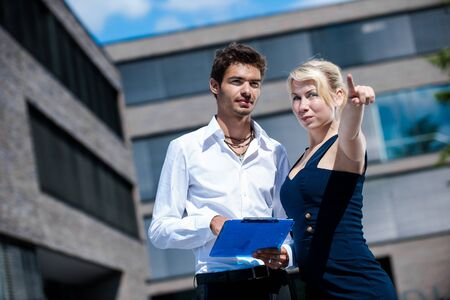 architectural survey: Businesswoman with board explaining a female colleague a project Stock Photo