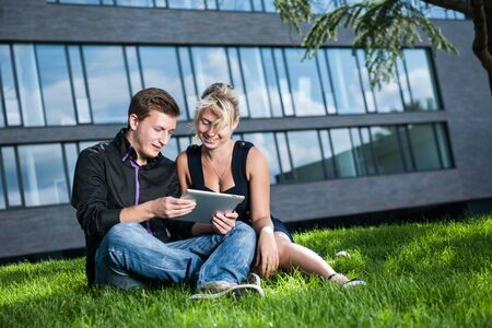 two business people discussing a project on Tablet Computers Stock Photo - 17718290