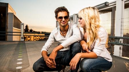 amorous couple at sunset on a garage Stock Photo - 17718255