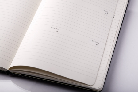 black notebook and white background