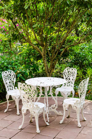 Tables, chairs and trees Stock Photo - 25028017