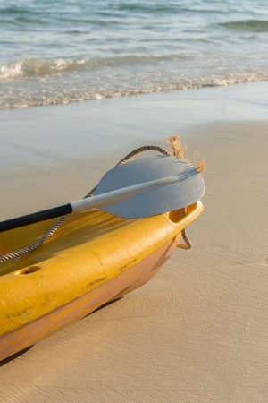 emty: The emty yellow kayak  on the beach ready for paddler.