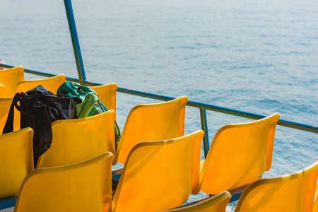 fiberglass: Black and mint bags on a plastic fiberglass chairs of ferry boat. Selective Focus.