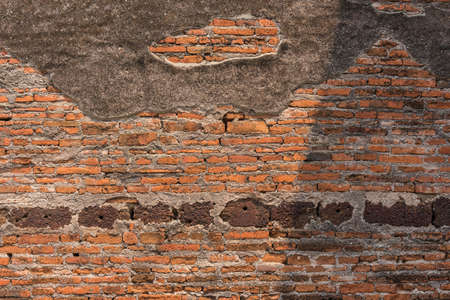 oldness: Concrete and brick wall of ancient remains in Thailand.