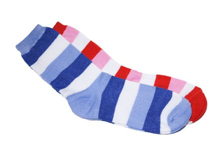 warm things: Two pairs childrens striped socks of bright red and dark blue color on a white background. path, excluding shadow.