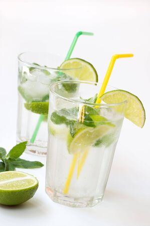 Cocktail of Mohito decorated lime and mint. Stock Photo