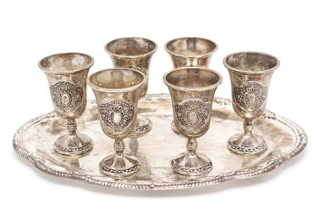 Silver wine-glasses on a tray. Isolated on a white background. A shade below. Stock Photo