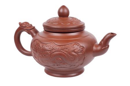 Teapot with a dragon isolated on a white background  photo