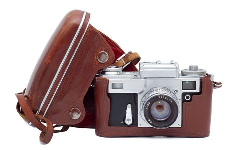 Old camera in cover isolated on white background. photo